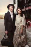 Stylish couple on vintage railway station Stock Photo