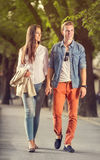 Stylish couple walks in the park Royalty Free Stock Images