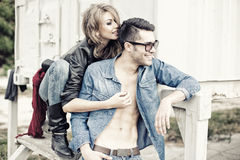 Stylish couple wearing jeans and boots smiling Stock Image
