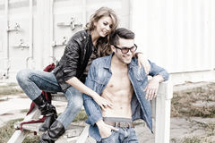 Stylish couple wearing jeans and boots smiling Royalty Free Stock Photo