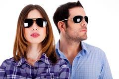 Stylish couple wearing sunglasses royalty free stock photography