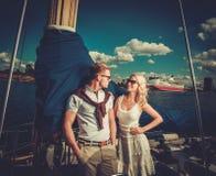 Stylish couple on a yacht. Stylish wealthy couple on a yacht Stock Photography