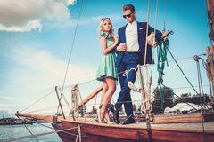 Stylish couple on a yacht Stock Photography