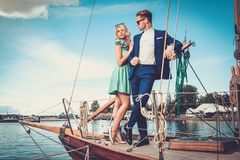 Stylish couple on a yacht Stock Photo
