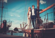 Stylish couple on a yacht Royalty Free Stock Image