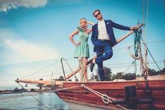 Stylish couple on a yacht Stock Photography