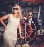 Stylish couple on a yacht Royalty Free Stock Photo