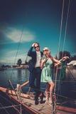 Stylish couple on a yacht Stock Photos