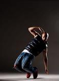 Stylish dancer over dark background Royalty Free Stock Photo
