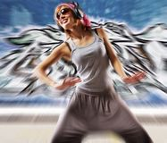 Stylish dancing girl against abstract wall Stock Image