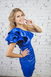 Stylish  dancing  Girl in luxurous blue dress Royalty Free Stock Image