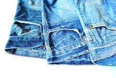 Stylish dark blue jeans. On a white background Royalty Free Stock Photography