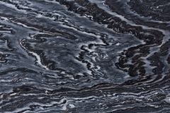 Stylish dark quartzite texture with ornamental surface. stock photo