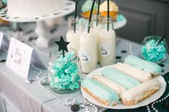 Stylish  decorated  children candy bar with balloons at the  birthday party. Holiday celebration concept with stars and moon Royalty Free Stock Image