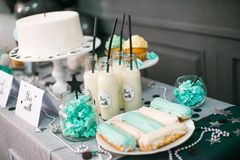 Stylish  decorated  children candy bar with balloons at the  birthday party. Holiday celebration concept with stars and moon Stock Image