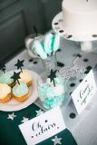Stylish  decorated  children candy bar with balloons at the  birthday party. Holiday celebration concept with stars and moon Royalty Free Stock Photos