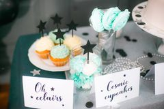 Stylish  decorated  children candy bar with balloons at the  birthday party. Holiday celebration concept with stars and moon Stock Photos