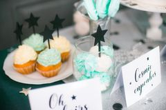 Stylish  decorated  children candy bar with balloons at the  birthday party. Holiday celebration concept with stars and moon Royalty Free Stock Images