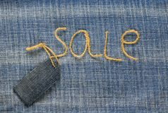 Stylish denim fabric background with the inscription sale of twi Stock Images