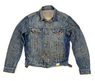 Stylish denim jacket buttoned. Old denim jacket light wash buttoned ripped and torn Royalty Free Stock Photography