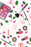 Stylish desk with woman cosmetics, accessories and pink roses on white background. Flat lay, top view. Beauty background. Stylish desk with woman cosmetics Stock Photography