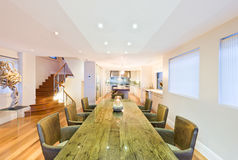 Stylish dining room with green table Royalty Free Stock Photography