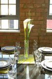 Stylish dining table. Contemporary stylish  dining table with flower set Royalty Free Stock Photography