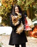 Stylish dog with owner gone shopping Royalty Free Stock Image