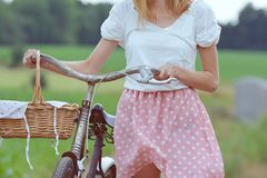 Stylish dressed girl on an old bicycle with a retro effect Royalty Free Stock Photos