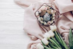 Stylish easter egg with floral ornaments in nest of flowers and royalty free stock photography