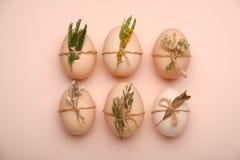 Stylish eggs with decorative elements on beige background. Stylish eggs with decorative elements on beige background Royalty Free Stock Photo