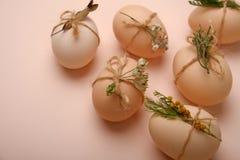 Stylish eggs with decorative elements on beige background. Stylish eggs with decorative elements on beige background Stock Photo
