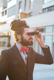 Stylish elegant dreadlocks businessman binoculars Stock Images