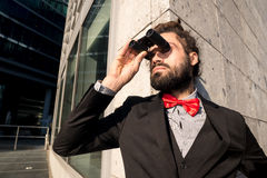 Stylish elegant dreadlocks businessman binoculars Royalty Free Stock Photo