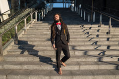 Stylish elegant dreadlocks businessman listening music Stock Photography