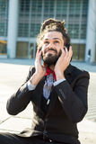 Stylish elegant dreadlocks businessman listening to music in bus Stock Photography
