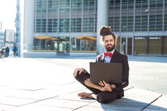 Stylish elegant dreadlocks businessman using notebook Royalty Free Stock Photo