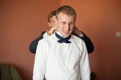 Stylish elegant groom getting ready for a wedding on a backgroun Royalty Free Stock Photos
