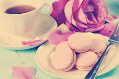 Stylish, elegant, shabby chic style afternoon tea tray with retro filter. Stylish, elegant, shabby chic style vintage aqua blue tray with macarons, cup of tea Royalty Free Stock Images