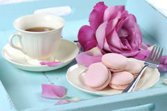 Stylish, elegant, shabby chic style afternoon tea tray. Stylish, elegant, shabby chic style vintage aqua blue tray with macarons, cup of tea and bright pink rose Stock Images