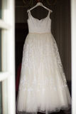 Stylish elegant white wedding dress hanging in hotel. Room Stock Photo