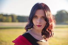 Stylish elegant woman at sunset outdoor Royalty Free Stock Images