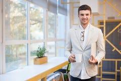 Stylish employee with laptop. Closeup of stylish employee with laptop Stock Images