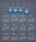 Stylish English calendar for 2016 on linen texture with jeans ta. Gs hung on thread. Vector illustration Stock Photo
