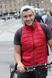 Stylish ethnic man riding a bicycle in the city.  Royalty Free Stock Photo