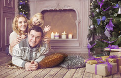 Stylish family celebrating christmas in room near the christmas Royalty Free Stock Image