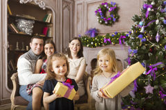 Stylish family celebrating christmas in room over christmas tree Stock Photos