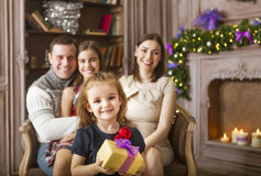 Stylish family celebrating christmas in room over christmas tree Royalty Free Stock Image