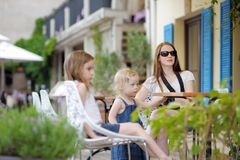 Stylish family in outdoor restaurant Stock Photos