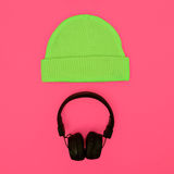 Stylish fashion accessories: hat and headphones on a pink backgr Royalty Free Stock Photos